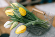 bouquet of yellow tulips on wooden table