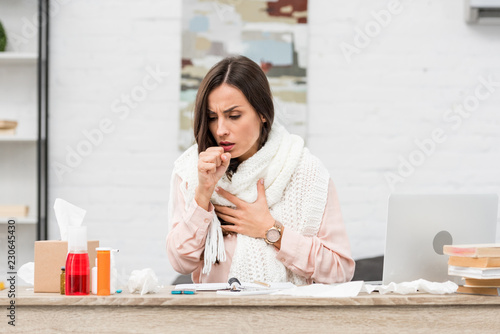 Fotografie, Obraz sick young businesswoman having cough at workplace