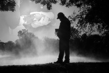 This Black And White Photo Illustration Shows An Adult Male Reflecting On Past Military Service And Lost Companions On Veteran's Day Or Memorial Day.