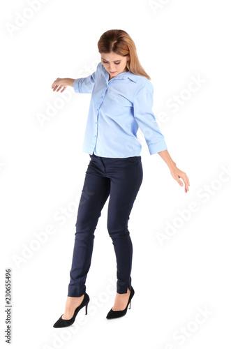 Photo  Full length portrait of businesswoman balancing on white background