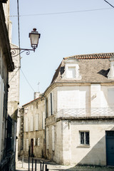 Fototapeta na wymiar Street view in old french town with traditional architecture