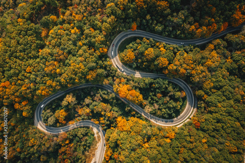 Foto op Canvas Luchtfoto Road seen from above. Aerial view of an extreme winding curved road in the middle of the forest