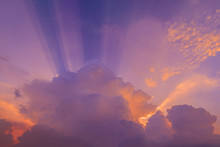 Beautiful Radiant Sun Lighting In Twilight. Colorful Brightly Soft And Fluffy Clouds On Purple Sky After Hard Raining. Background For Business Target Or Meteorology Presentation Or Inspiration Concept