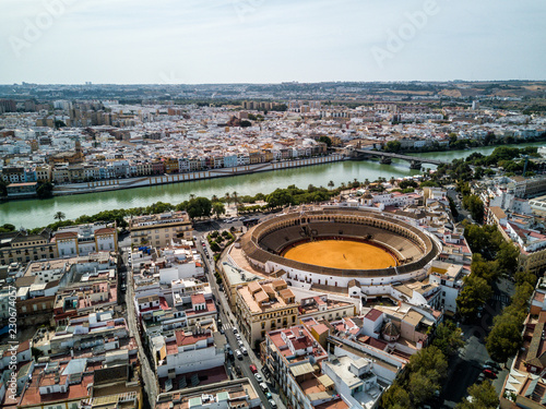 Foto  Aerial drone photo - Iconic bullfighting ring, Plaza de Toros, of Seville (Sevilla) Spain