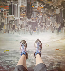 FototapetaLegs of a woman in sneakers relaxing in sky. Invert city upside down .Future modern business industry concept: Big city on amazing sky at Bangkok, Thailand, Asia