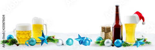 Beer in bottle and in glass with Christmas decoration isolated