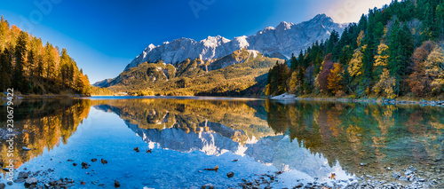 Fotobehang Herfst Panorama image of mountains with water reflection in the lake