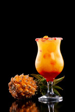 Closeup Glass Of Mai Tai Cocktail Decorated With Pineapple Isolated At Black Background.
