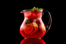 Glass Jar Of Red Wine Sangria With Wild Berries And Citrus Mix Isolated At Black Background.