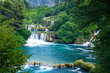 Waterfalls Among Green Plants In Krka National Park, Dalmatia, Croatia