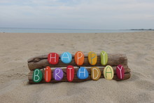 Happy Birthday Creative Message With A Unique Composition Of Colored Stone Letters On The Beach