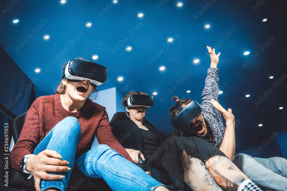 Fototapety, obrazy: friends in virtual glasses watching movies in the cinema with special effects in 5d