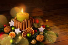 Festive Christmas Arrangement With Burning Candle And Natural Decoration On Rustic Wood