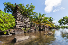 A Channel And Town Walls In Nan Madol - Prehistoric Ruined Stone City Built Of Basalt Slabs. Ancient Walls Were Built On Coral Artificial Islands In The Lagoon Of Pohnpei, Micronesia, Oceania