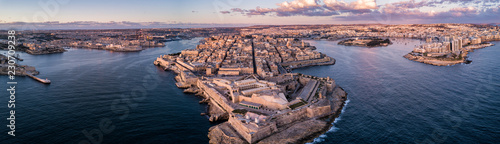 Aerial drone panorama sunrise photo - Ancient capital city of Valletta Malta.  Island Country of Europe in the Mediterranean Sea