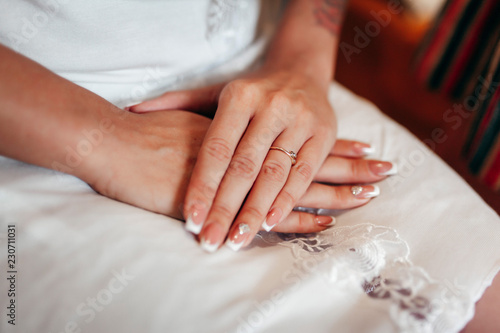 Aluminium Prints Manicure Close-up of tender ring on bride's hand with white nails