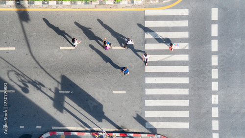 Valokuva  people crowd walk in top view at street city with pedestrian crosswalk in traffi