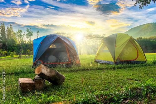 Poster Camping Outdoor camping scenery with sunny day and background of mount,Morning light.