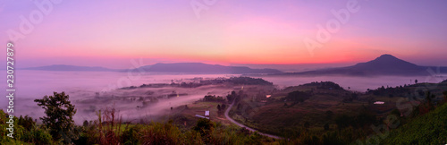 Spoed Foto op Canvas Purper Panorama view of sea mist at the mountain in sunrise time