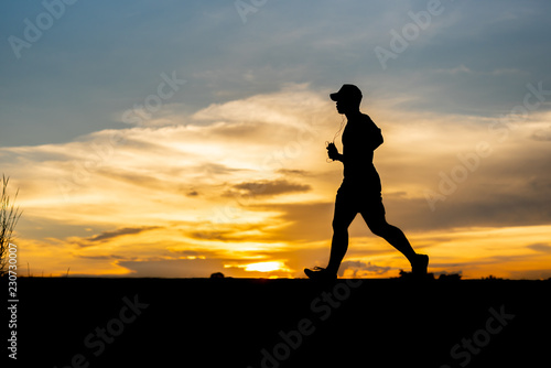 Deurstickers Vechtsport silhouette running alone at beautiful sunset in the park.