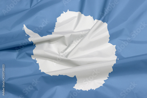 Foto op Canvas Antarctica Fabric flag of Antarctica. Crease of Antarctica flag background. A plain white map of the continent on a blue background.