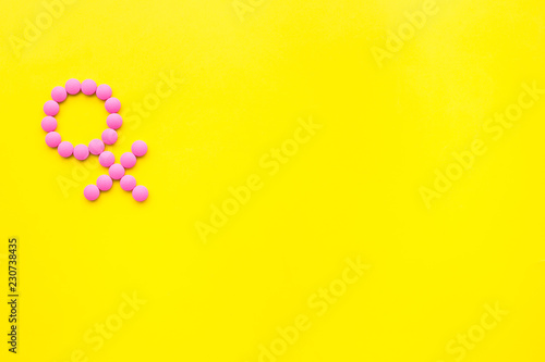 Female diseases  Female gender icon symbol made of pills on yellow