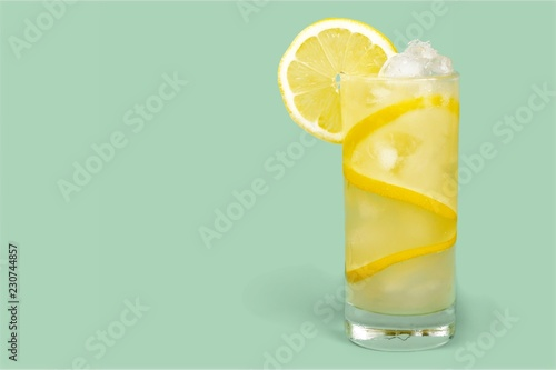 Lemonade with fresh lemon on  background