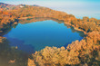 Picturesque mountain forest lake in autumn at sunrise. Lake near the sea. Beautiful wild nature. Aerial view