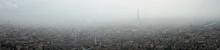 Panoramic View Of Paris In The Fog