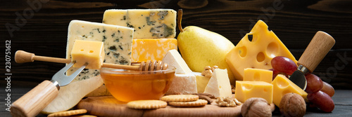 Fototapeta Various types of cheese on a rustic table obraz