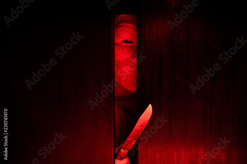 Serial killer / eye peeking behind the door with kinfe Canvas Print