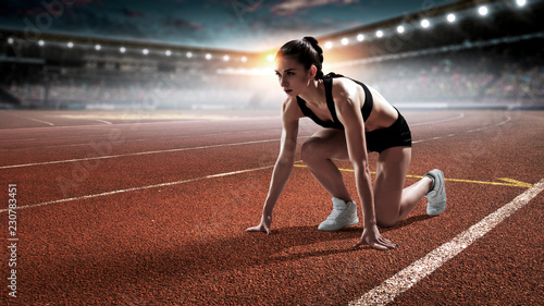 Female athlete ready to run. Mixed media Wallpaper Mural