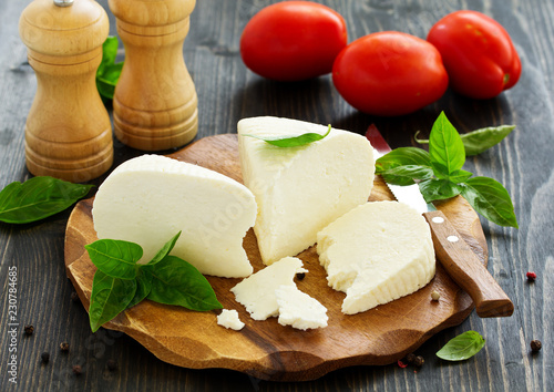 cheese brynza and garlic on a cutting board.