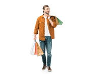 Happy Man Walking With Colorful Shopping Bags Isolated On White
