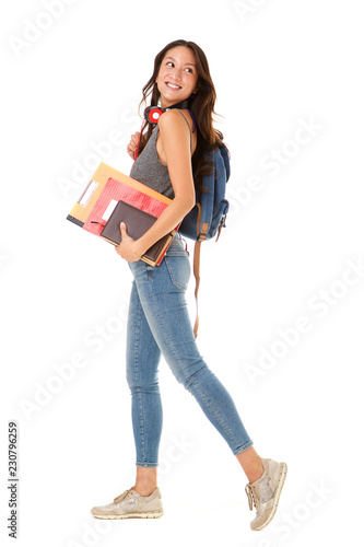 Photo  Full length smiling asian college student walking against isolated white backgro