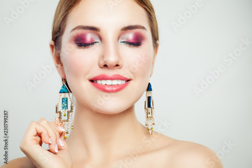 Foto op Plexiglas Beauty Perfect woman face closeup. Young beautiful female model with makeup smiling
