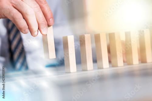 Fotografía  Concept of business progress with wood blocks, light effect