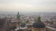 Aerial: Cityscape of Lviv in misty weather