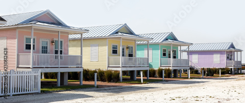 Foto Colorful pastel summer rental cottages.