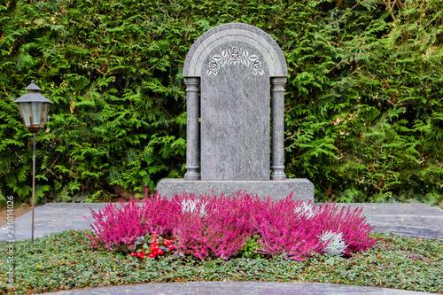 Blank gravestone of a dead person on a cemetery Fototapeta