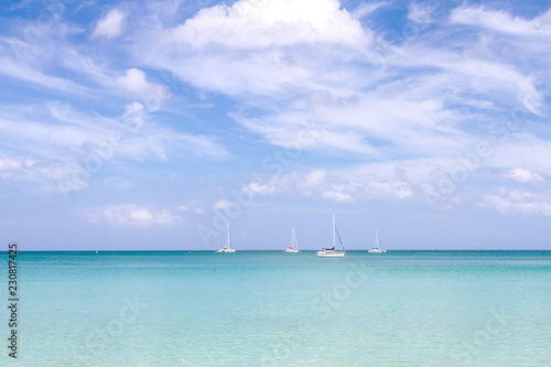 Spoed Foto op Canvas Zee / Oceaan Sea sand sky and soft wave of blue ocean on sandy beach summer day. Background