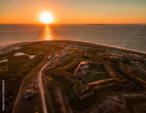 Fotografie, Tablou Stunning drone/aerial photograph of an ocean sunset over a Civil War fortress, Fort Morgan, & the Gulf of Mexico