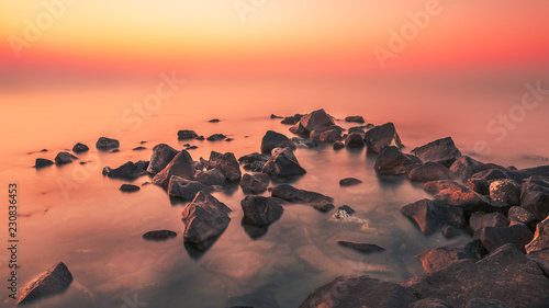Poster Corail sunset sea hot rocks
