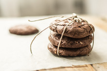 Homemade Tower Of Chocolate Chip Cookies On The Parchment Paper Tied With String, One Cookie On A Side