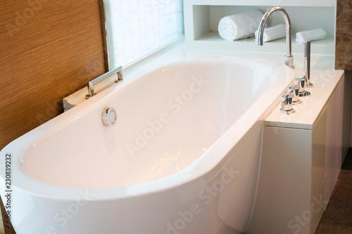Tablou Canvas Bathroom interior in cozy colors with modern bathtub