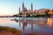 Beautiful sunrise landscape in Zaragoza. Spain. Aragon. Basilica of Our Lady of the Pillar in Zaragoza and Ebro River.