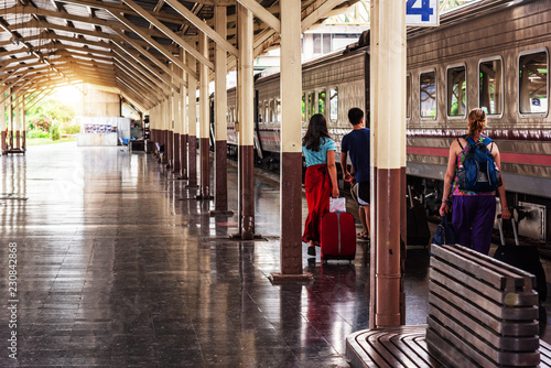 Fototapety, obrazy: Traveler tourist are walking and dragging luggage for take the train at railway station
