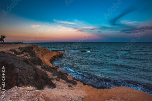 Poster Diepbruine Landscape shot of Mil Palmeras seashore in the evening, Spain