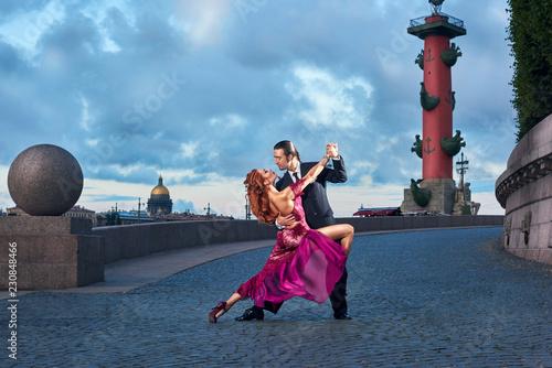 Fototapeta Young, beautiful and professional couple dancing tango in Saint-Petersburg at Va