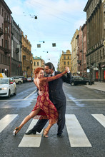 Young, Beautiful And Professional Couple Dancing Tango On The Pedestrian Precinct Of Saint-Petersburg